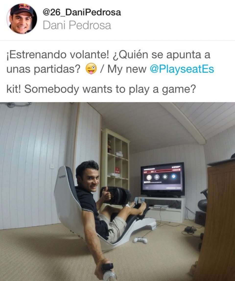 Dani Pedrosa relaxes by playing with the Playstation