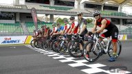 At Sepang the riders challenge each othher on two wheels... on bicycles