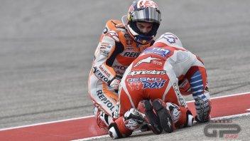 Dani Pedrosa on his knees with Dovizioso